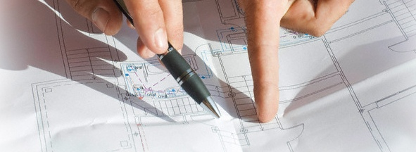 Hands pointing at construction plan